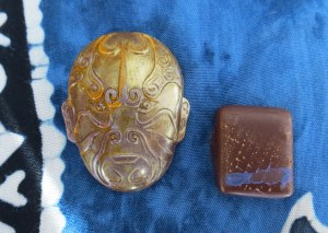 Bon bon on left: Caramelized champagne mango with Scorpion chilis blended with Danta's magnificent La Soledad criollo 40% milk chocolate from Guatemala, finished in Tango 67% Dark chocolate. On right: Almond gianduja of Red Rack Ale and fresh blood orange juice in Axiom 60% dark chocolate.